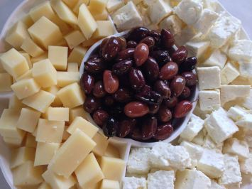 Yellow cheese, feta, and olives