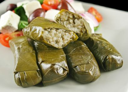 Greek dolmades wrapped with vine leaves and rice with salad.